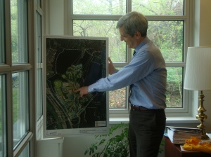 Pace's Senior Vice President and Senior Administrative Officer for the Westchester Campus William McGrath displaying details of the Master Plan of the Pleasantville campus. (Photo Credit: Michael Oleaga).